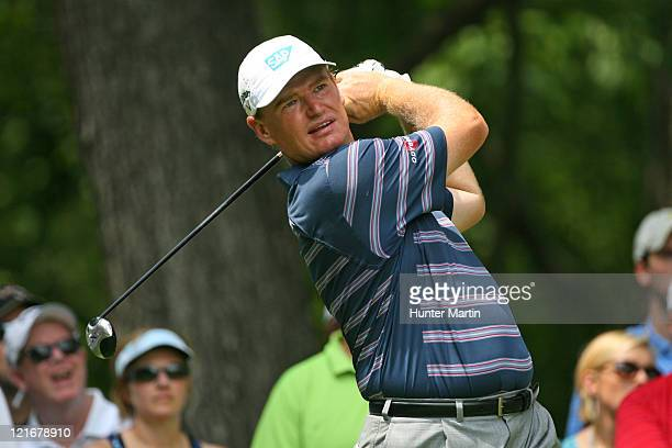 Ernie Els of South Africa hits his tee shot on the second hole during the final round of the Wyndham Championship at Sedgefield Country Club on...