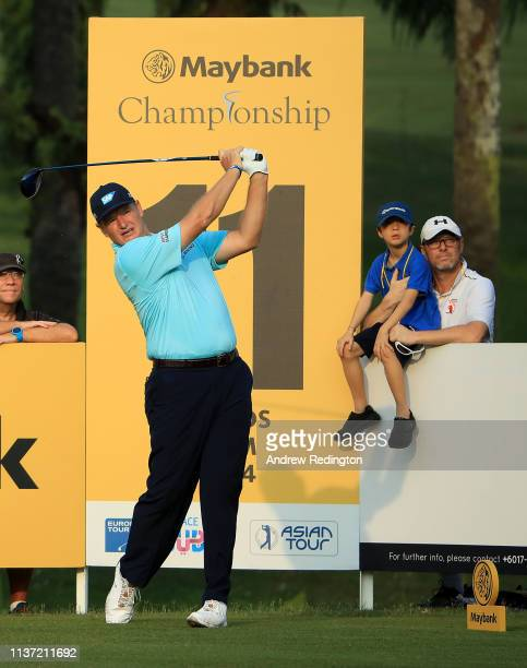 Ernie Els of South Africa hits his teeshot on the 11th hole on Day One of the Maybank Championship at Saujana Golf Country Club Palm Course on March...