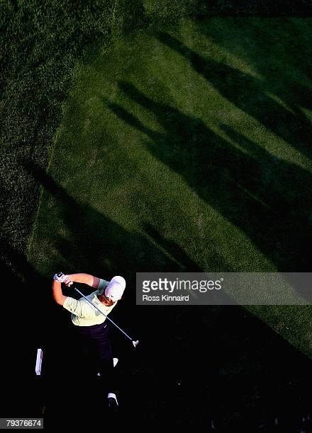 Ernie Els of South Africa hits off a tee during the pro-am event prior to the Dubai Desert Classic on the Majlis Course held at the Emirates Golf...