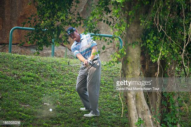 Ernie Els of South Africa hits out of the rough on the 17th hole during round two of the Venetian Macau Open on October 18 2013 at the Macau Golf...