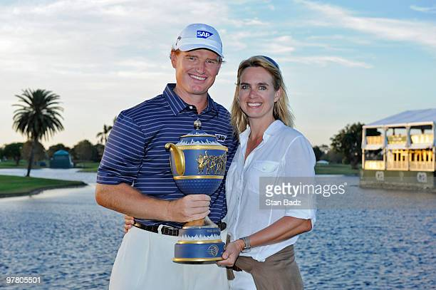 Ernie Els of South Africa hold the winner's trophy with his wife Liezl after the final round of the World Golf ChampionshipsCA Championship at Doral...