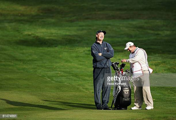 Ernie Els of South Africa laughs with his caddy during the ProAm at the HSBC World Match Play Championship at Wentworth Golf Club on October 13 2004...