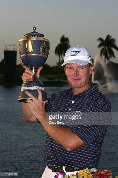 Ernie Els of South Africa lifts the Gene Sarazen Cup trophy on the 18th hole after winning the 2010 WGCCA Championship at the TPC Blue Monster at...