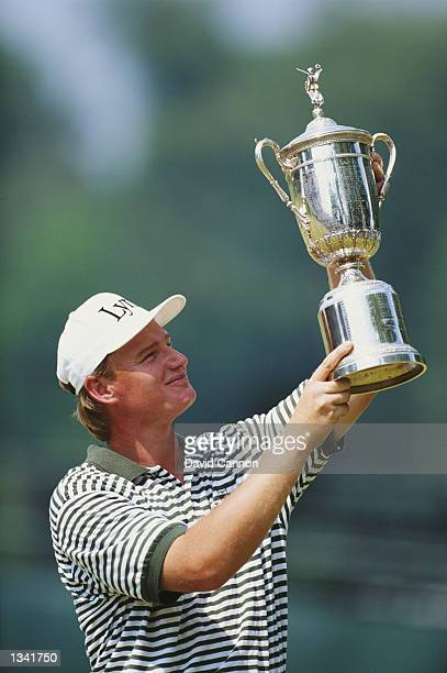 Ernie Els of South Africa lifts the trophy after victory in the US Open at Oakmont Country Club in Pennsylvania USA on June 20 1994