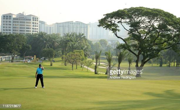 Ernie Els of South Africa lines up a putt on the 12th hole on Day One of the Maybank Championship at Saujana Golf Country Club Palm Course on March...