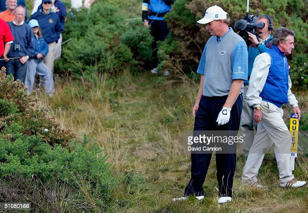 Ernie Els of South Africa looks at his ball after his drive landed in a gorse bush on the 12th hole during the final round of the 133rd Open...