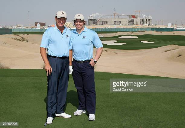 Ernie Els of South Africa on the par 3 4th hole with John Smit of South Africa during the opening day of the Els Course at Dubai Sports City on...