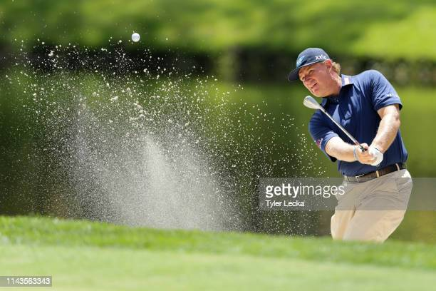 Ernie Els of South Africa plays a shot from a bunker on the eighth hole during the first round of the 2019 RBC Heritage at Harbour Town Golf Links on...