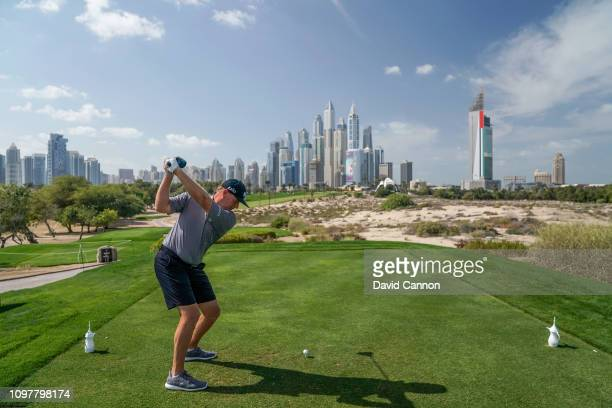 Ernie Els of South Africa plays a shot from the eighth tee as a preview for the Omega Dubai Desert Classic on the Majlis Course at the Emirates Golf...