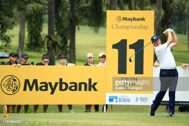 Ernie Els of South Africa plays a shot off the 11th tee during Day Four of the Maybank Championship at Saujana Golf Country Club Palm Course on March...