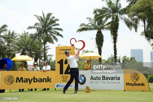 Ernie Els of South Africa plays a shot off the 12 during Day Four of the Maybank Championship at Saujana Golf Country Club Palm Course on March 24...