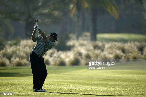 Ernie Els of South Africa plays his approach to the par 5 10th hole during the opening round of the 2003 Dubai Desert Classic on the Majilis Course...