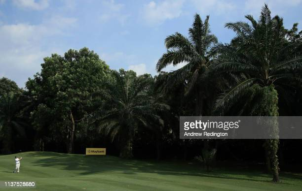 Ernie Els of South Africa plays his second shot on the 15th hole on Day Two of the Maybank Championship at at Saujana Golf Country Club Palm Course...
