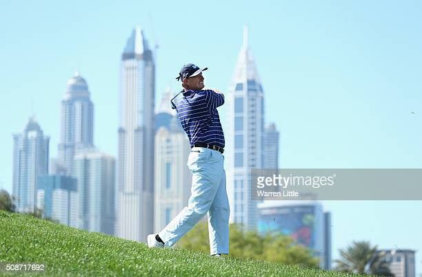 Ernie Els of South Africa plays his second shot on the 6th hole during the third round of the Omega Dubai Desert Classic at the Emirates Golf Club on...