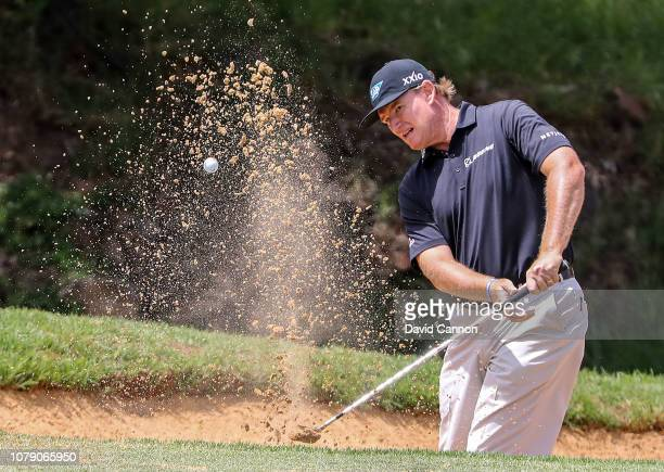 Ernie Els of South Africa plays his second shot on the par 3 eighth hole during the third round of the South African Open on the Firethorn Course at...