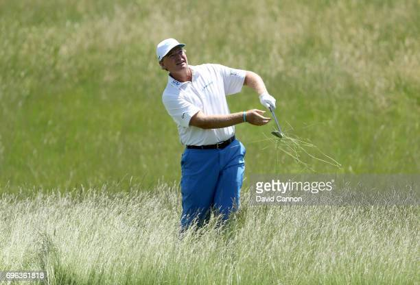 Ernie Els of South Africa plays his second shot on the par 4 15th hole during the first round of the 117th US Open Championship at Erin Hills on June...