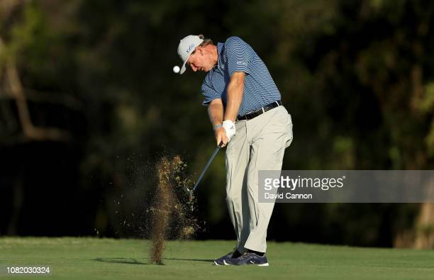 Ernie Els of South Africa plays his second shot on the par 4 17th hole during the first round of the Alfred Dunhill Championships at Leopard Creek...