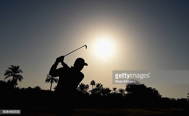 Ernie Els of South Africa plays his second shot on the par five 10th hole during the second round of the Omega Dubai Desert Classic on the Majlis...