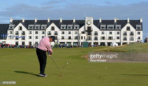 Ernie Els of South Africa plays his second shot to the par four 18th hole during the first round of the 2013 Alfred Dunhill Links Championship at the...