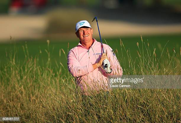 Ernie Els of South Africa plays his third shot at the par 5 10th hole during the second round of the 2016 Omega Dubai Desert Classic on the Majlis...