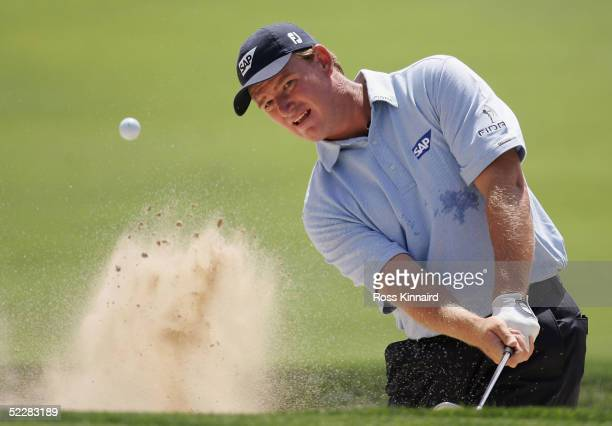 Ernie Els of South Africa plays his third shot on the par four first hole during the final round of the Dubai Desert Classic on the Majlis Course at...