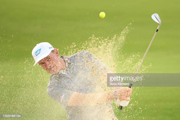Ernie Els of South Africa plays out of a bunker on the 18th hole during Day 2 of the Saudi International at Royal Greens Golf and Country Club on...