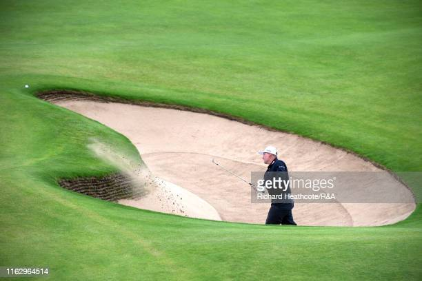 Ernie Els of South Africa plays out of the bunker on the thirteenth hole during the second round of the 148th Open Championship held on the Dunluce...