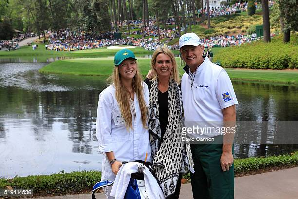 Ernie Els of South Africa poses with his wife Liezl and daughter Samantha during the Par 3 Contest prior to the start of the 2016 Masters Tournament...