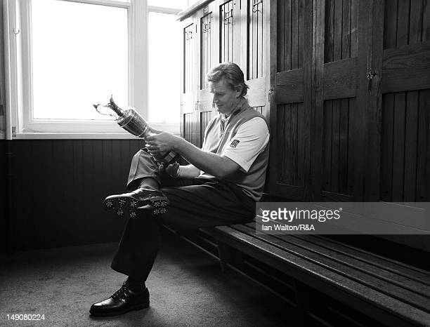 Ernie Els of South Africa poses with the Claret Jug in the locker room following his victory at the end of the final round of the 141st Open...