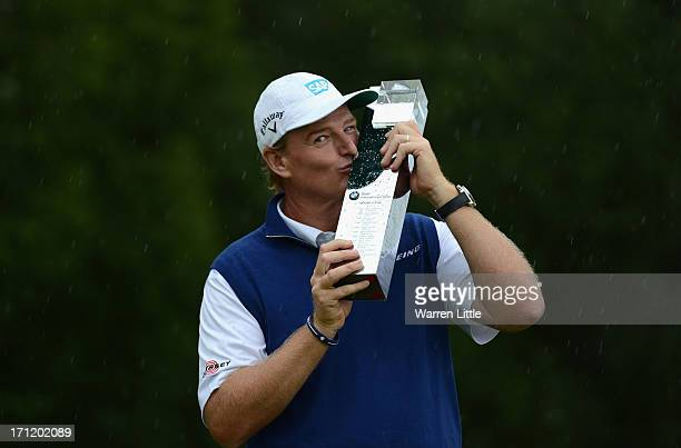 Ernie Els of South Africa poses with the trophy after winning the BMW International Open at Golfclub Munchen Eichenried on a score of 18 under par on...