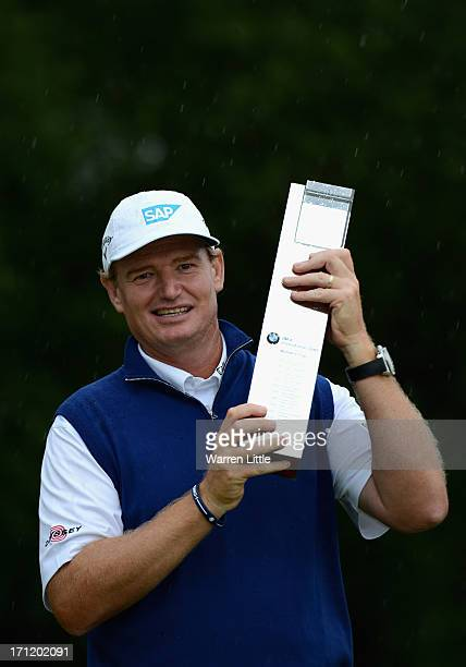 Ernie Els of South Africa poses with the trophy after winning the BMW International Open at Golfclub Munchen Eichenried on a score of -18 under par...