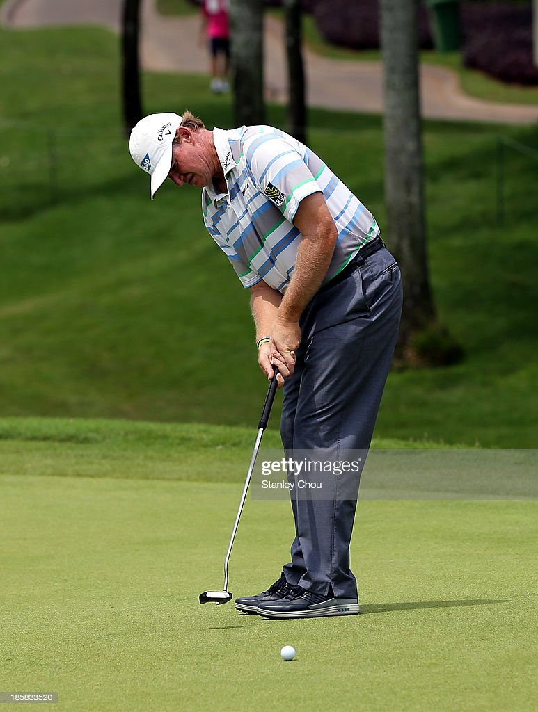 Ernie Els of South Africa putts on the 18th hole during round two of the CIMB Classic at Kuala Lumpur Golf & Country Club on October 25, 2013 in Kuala Lumpur, Malaysia.