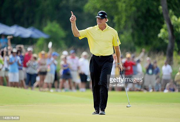 Ernie Els of South Africa reacts to his par saving putt on the 17th green during the final round of the Zurich Classic of New Orleans at TPC...