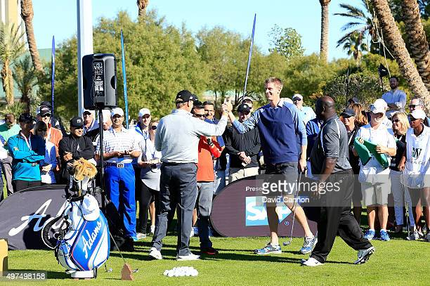 Ernie Els of South Africa reacts with Kevin Anderson of South Africa the ATP Tennis player and Dommie Frazier the former NFL Quarter Back during the...