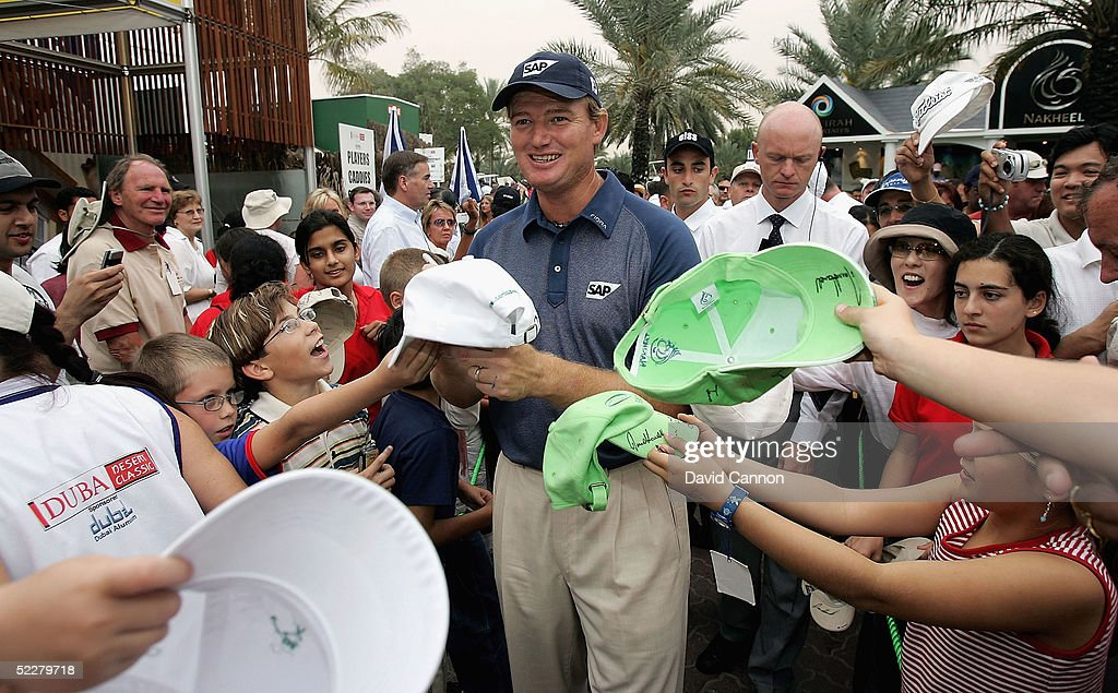 Ernie Els of South Africa signs autographs after the end of the third round of the 2005 Dubai Desert Classic on the Majilis Course at the Emirates Golf Club, on March 05, 2005, in Dubai, United Arab Emirates.