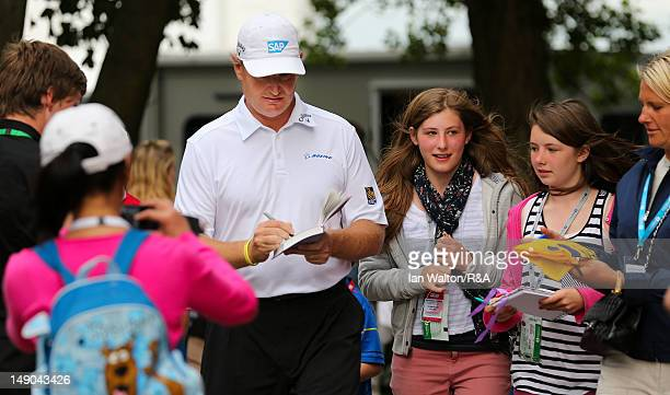 Ernie Els of South Africa signs autographs for spectators after completing his final round of the 141st Open Championship at Royal Lytham St Annes...
