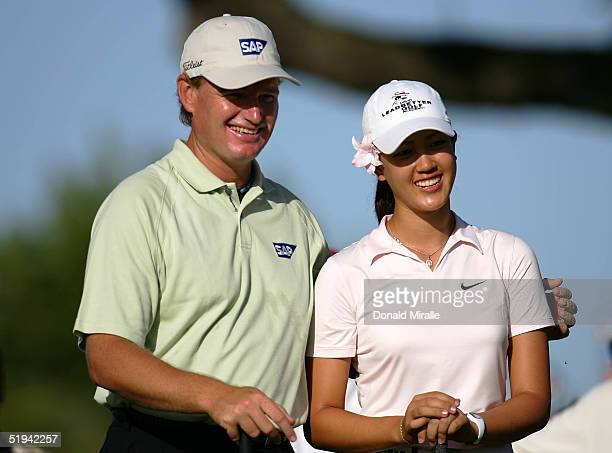 Ernie Els of South Africa smiles with Michelle Wie of the USA during the ProAm of the Sony Open at the Waialae Country Club on January 12 2005 in...