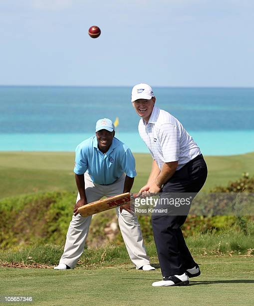Ernie Els of South Africa tries his had at cricket with former test star Brian Lara keeping wicket during the pro-am event prior to the PGA Grand...