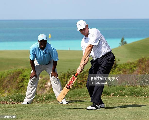 Ernie Els of South Africa tries his hand at cricket with former test star Brian Lara keeping wicket during the proam event prior to the PGA Grand...