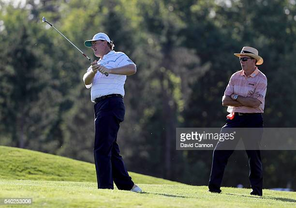 Ernie Els of South Africa under the watchful eye of coach David Leadbetter during a practice round prior to the 2016 USOpen at Oakmont Country Club...