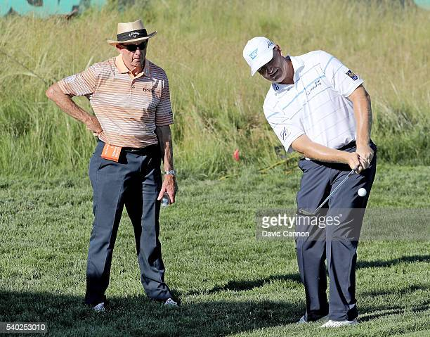 Ernie Els of South Africa under the watchful eye of coach David Leadbetter during a practice round prior to the 2016 U.S.Open at Oakmont Country Club...