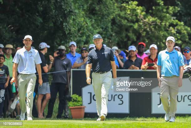 Ernie Els of South Africa walks off the 18th tee with his nephew Jovan Rebula of South Africa and Robert MacIntyre of Scotland during the third round...