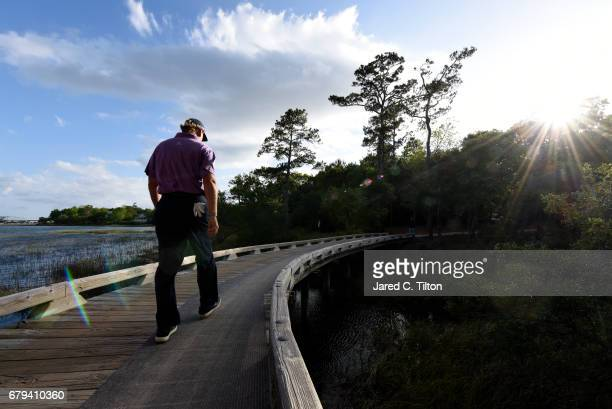 Ernie Els of South Africa walks to the 11th tee during round two of the Wells Fargo Championship at Eagle Point Golf Club on May 5 2017 in Wilmington...