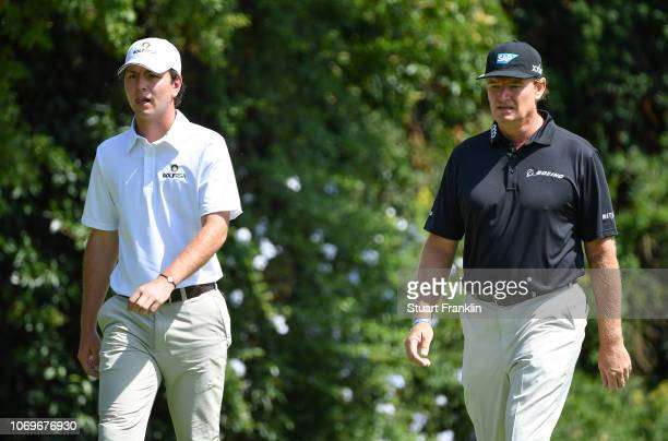 Ernie Els of South Africa walks with his nephew Joyan Rebula of South Africa during the third round of the South African Open at Randpark Golf Club...