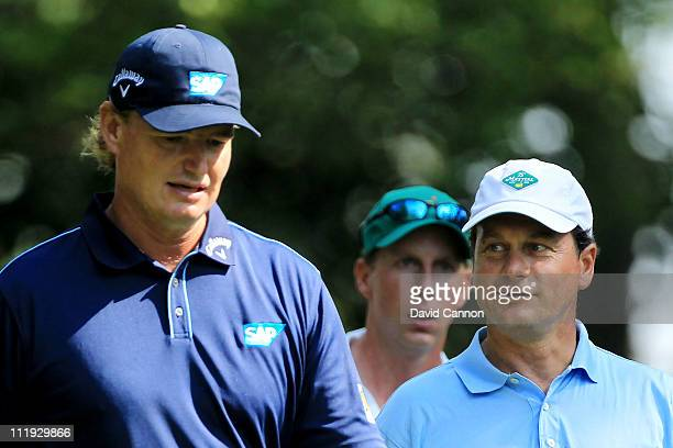 Ernie Els of South Africa walks with Jeff Knox playing as a noncompeting marker on the second hole during the third round of the 2011 Masters...