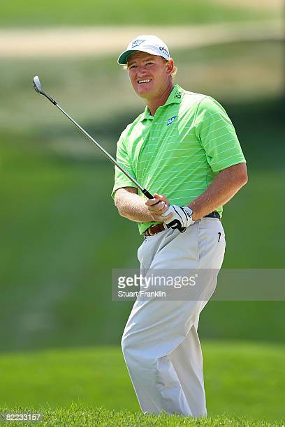 Ernie Els of South Africa watches his shot on the sixth hole during round three of the 90th PGA Championship at Oakland Hills Country Club on August...