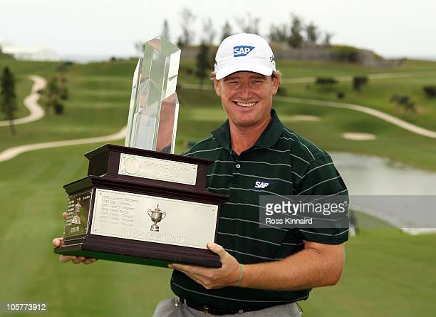 Ernie Els of South Africa with the winners trophy after the final round of the 2010 PGA Grand Slam of Golf at The Port Royal Golf Course on October...