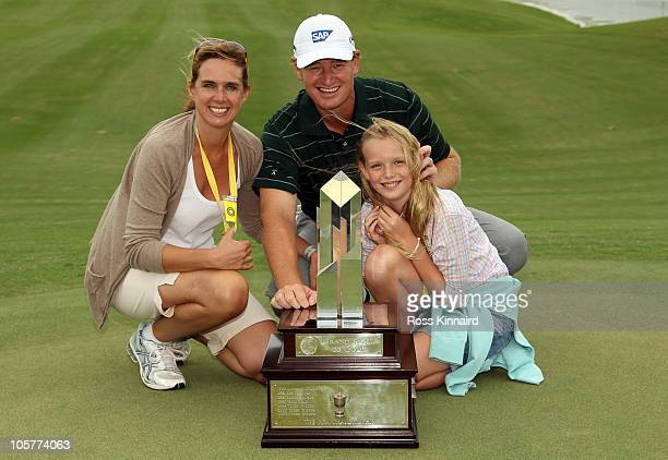 Ernie Els of South Africa with the winners trophy is pictured with hs wife Liezl and daughter Samantha after the final round of the 2010 PGA Grand...