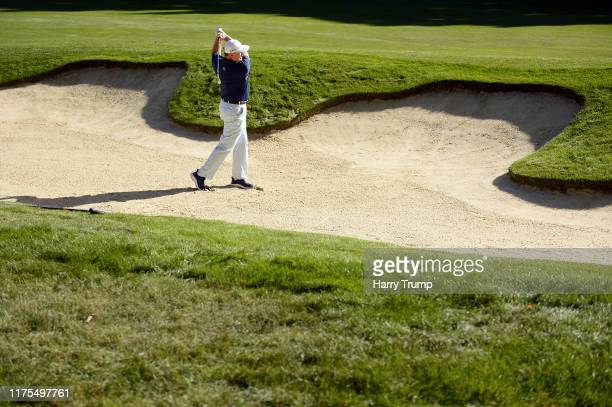 Ernie Els plays a shot out of the bunker during the BMW PGA Championship Pro-Am at Wentworth Golf Club on September 18, 2019 in Virginia Water,...