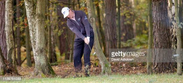 Ernie Els plays from the trees during the final round of the Golf Match Play at Wentworth Golf Club England 17th October 2004.